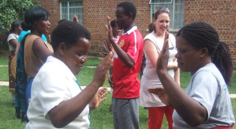 Annie Smith teaching mirror reflections to students in Malawi