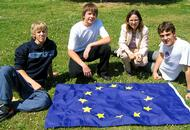 EU students on a lawn with an EU flag